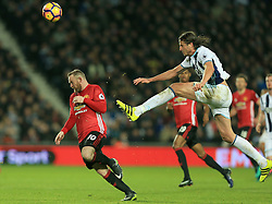 17 December 2016 - Premier League - West Bromwich Albion v Manchester United - Jonas Olsson of West Bromwich Albion clears the ball as Wayne Rooney of Manchester United reacts - Photo: Paul Roberts / Offside.
