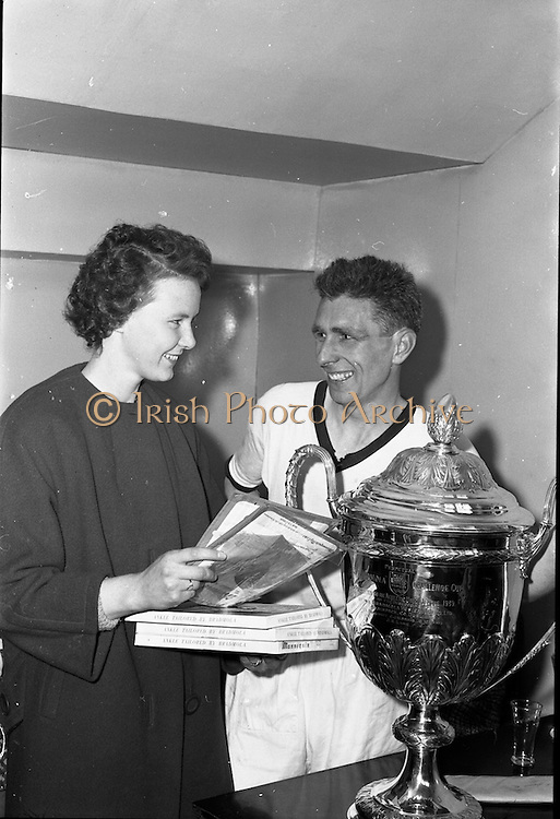 27/05/1962<br /> 05/27/1962<br /> 27 May 1962<br /> Railway Union win the Bradmola Cup at Tolka Park. (Original Caption) Hugh Egan, Captain of Railway Union, who beat Tolka Rovers 4-1,was very proud of the Bradmola Cup, which they won. But his pretty wife Bella was more interested in the nylons that went with it.