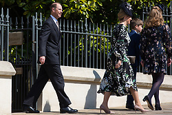 Windsor, UK. 21st April 2019. The Earl and Countess of Wessex, James, Viscount Severn, and Lady Louise Windsor leave St George's Chapel in Windsor Castle after attending the Easter Sunday service.