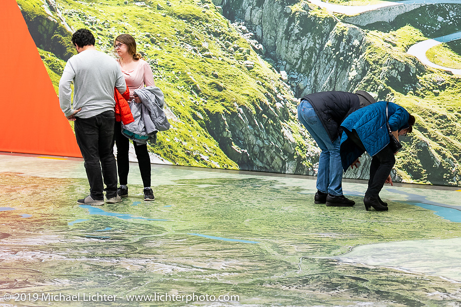 A giant floor augmented reality map of the Grand Tour of Switzerland at the Swiss-Moto Customizing and Tuning Show. Zurich, Switzerland. Saturday, February 23, 2019. Photography ©2019 Michael Lichter.