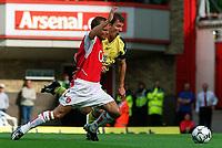 Fotball. Premier League. 21.09.2002.<br /> Arsenal v Bolton.<br /> Fredrik Ljungberg legges ned av Gudni Bengtsson og Arsenal får straffespark.<br /> Foto: David Price, Digitalsport