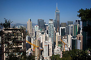 The view of Hong Kong and tall tower blocks seen from above Happy Valley. 7 million people live on 1,104km square, making it Hong Kong the most vertical city in the world.