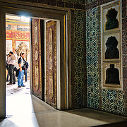 Tourists seen through a doorway in the Harem of the Topkapi Palace, the Ottoman palace in Istanbul's Sultanahmet district.