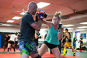 """UFC welterweight Donald """"Cowboy"""" Cerrone spars with UFC bantamweight Holly Holm at Jackson Wink MMA in Albuquerque, New Mexico on June 9, 2016."""