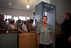 Galina Kukharchuk enters the crowded courthouse to file her papers after receiving help from attorneys and paralegals during a Òspecial consultationÓ for potential clients who are children of the Second World War, Rivne, Ukraine, June 16, 2011. This vulnerable group is made up of seniors, most of whom are not receiving proper compensation as promised by the government. The legal team advises them on how to properly fill out forms and submit them to the courthouse, while encouraging them not to give up on their rights. More than half of the worldÕs population, four billion people, live outside the rule of law, with no effective title to property, access to courts or redress for official abuse. The Open Society Justice Initiative is involved in building capacity and developing pilot programs through the use of community-based advocates and paralegals in Sierra Leone, Ukraine and Indonesia. The pilot programs, which combine education with grassroots tools to provide concrete solutions to instances of injustice, help give poor people some measure of control over their lives.