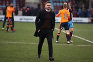 Scunthorpe United Manager Graham Alexander walks off the pitch  after the EFL Sky Bet League 1 match between Scunthorpe United and Oldham Athletic at Glanford Park, Scunthorpe, England on 3 March 2018. Picture by Mick Atkins.
