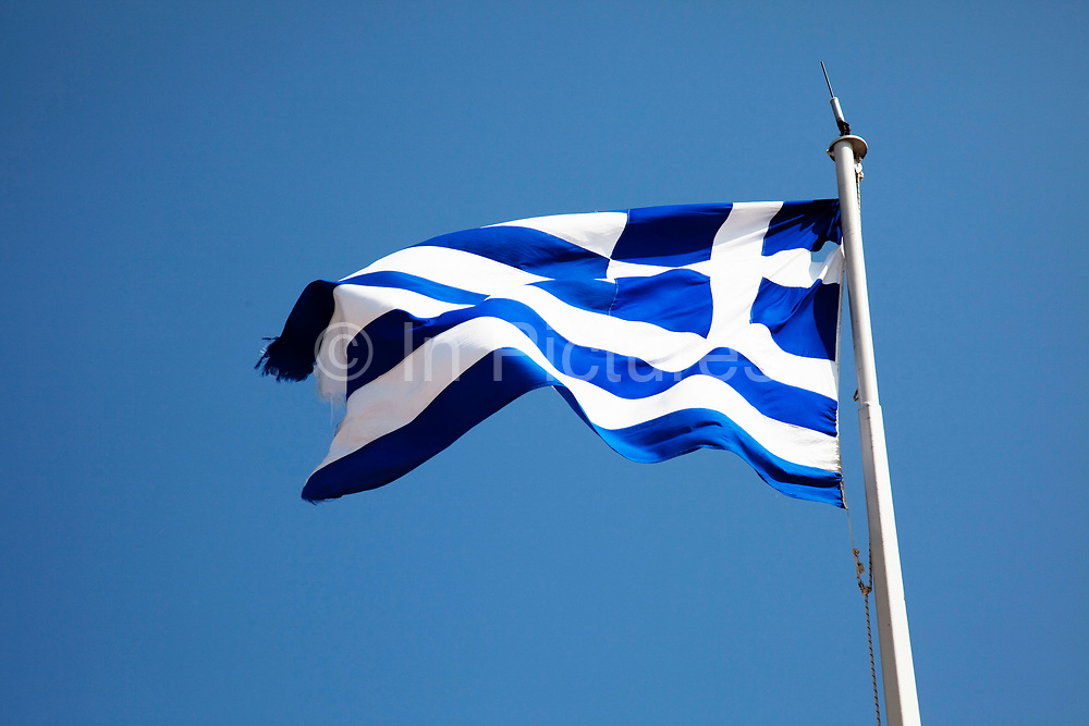 The flag of Greece (popularly referred to as the 'blue-white'), officially recognized by Greece as one of its national symbols, is based on nine equal horizontal stripes of blue alternating with white. There is a blue canton in the upper hoist-side corner bearing a white cross; the cross symbolises eastern orthodox christianity, the established religion of the Greek people of Greece and Cyprus.