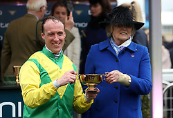 Jockey Robbie Power and Trainer Jessica Jane Harrington with the Timico Gold Cup after a winning ride on Sizing John in the Timico Cheltenham Gold Cup Chase during Gold Cup Day of the 2017 Cheltenham Festival at Cheltenham Racecourse.