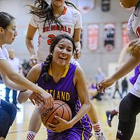 Kirtland Central Bronco Shayonna Begay (14) fights off Gallup Bengal Kalisha Kinsel (5) Tuesday at Gallup High School.
