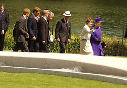 Britain's Queen Elizabeth II and the Culture Secretary Tessa Jowell lead members of the Royal family and other VIPs as they walk, past a fountain built in memory of Diana, Princess of Wales, in London's Hyde Park.