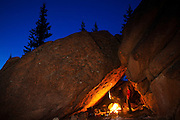 David Coffey (left) and Marco Binotti draw cave paintings by firelight in their cave camp in McMurdy Park, Lost Creek Wilderness, Colorado.