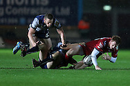 Rhys Patchell of the Scarlets is brought to ground. Guinness Pro12 rugby match, Scarlets  v Connacht at the Parc y Scarlets in Llanelli, West Wales on Saturday 24th September 2016.<br /> pic by  Andrew Orchard, Andrew Orchard sports photography.