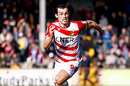 Doncaster Rovers forward John Marquis (9) in action  during the EFL Sky Bet League 1 match between Scunthorpe United and Doncaster Rovers at Glanford Park, Scunthorpe, England on 23 February 2019.