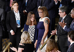 Susan Oliver , the widow of a California sheriff's deputy who was murdered allegedly by a twice deported illegal immigrant U.S. stands with her daughter Jenna during President Donald J. Trump first address to a Joint Session of Congress on Tuesday, February 28, 2017 at the Capitol in Washington, DC. Photo by Olivier Douliery/ Abaca