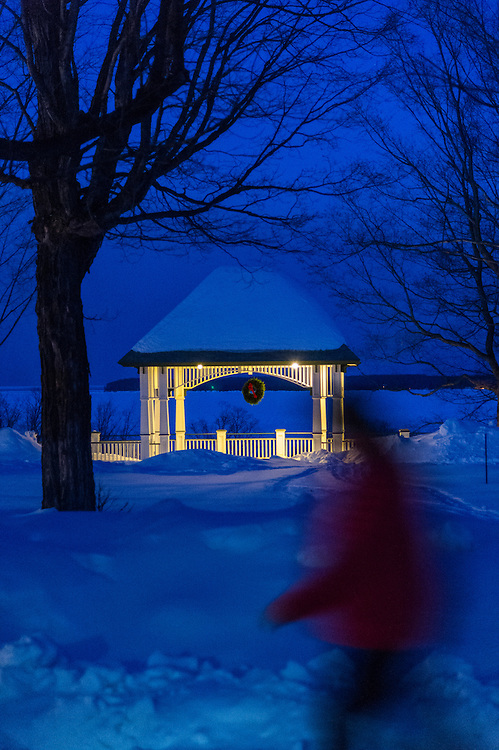 Participants in the Michigan DNR Becoming and Outdoors Woman program walk past a wintry gazebo at Bay Cliff Health Camp in Big Bay, Michigan.
