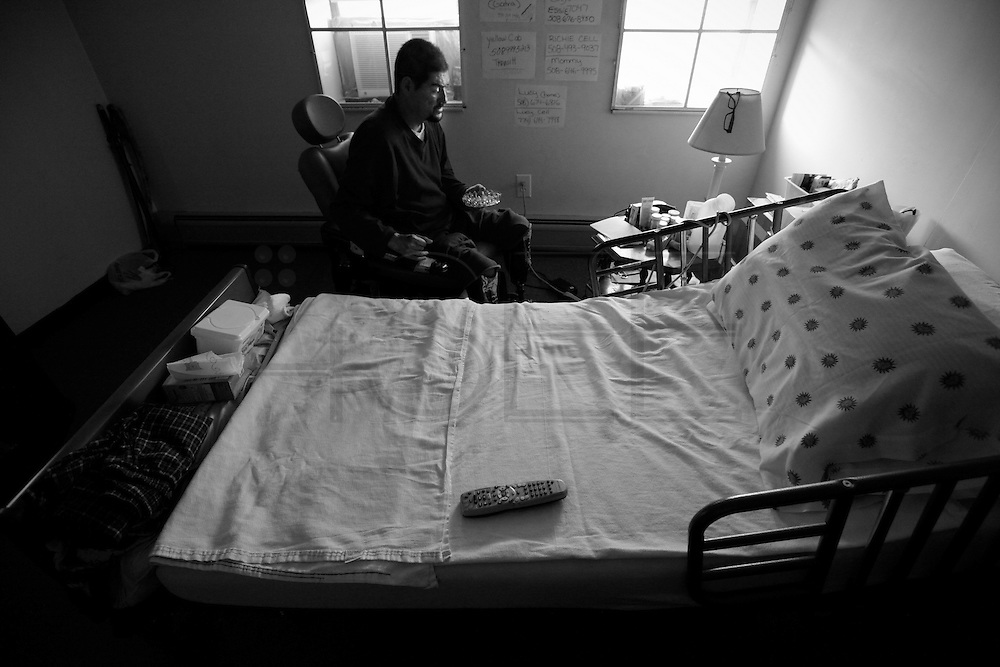 Alone in his room, Carlos grabs the ashtray for a smoke in an effort to pass the time away faster. Carlos Raposa, 49, deals with diabetes and has lost both legs under the knees to the disease. Ever since having his legs amputated,  As his condition has worstened over the years Carlos has had greater difficulty dealing with his condition.  Increasingly, Carlos has fallen greater into depression and has turned to smoking and drinking to deal with it.  What used to be monthly visits to the hospital has turned into weekly excursions with ever longer stays in hospital.  Family members have become ever more worried about Carlos' drop in weight and his inability to move on his own any longer.  For someone who was an athletic figure, Carlos has become a shadow of his former self.