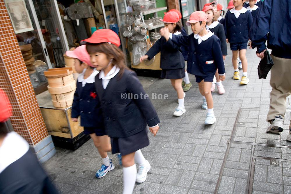 school children walking in a group Japan
