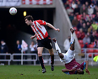 Photo. Glyn Thomas.<br /> Sunderland v West Ham United.<br /> Nationwide Division 1.<br /> Stadium of Light, Sunderland. 13/03/2004.<br /> West Ham's Marlon Harewood (R) is felled by Gary Breen.