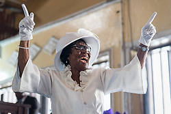 3 November 2019, Monrovia, Liberia: Tarina Grimes Kpardeh dances and sings as she celebrates her 80th birthday together with the congregation during Sunday service at the Providence Baptist Church, also known as 'the cornerstone of the nation', as it was in the Providence Baptist Church that Liberia's declaration of independence was signed. While this Sunday service is taking place in a larger worship space finalized in 1976, the old chapel remains in place adjacent to the new one, and is still in use.