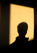 silhouette of a person looking out of a window