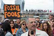 Tim Crosland from Plan B speaks at the Rise For Climate Change event held outside Tate Modern in London, England, United Kingdom on September 8th 2018. Tens of thousands of people joined over 830 actions in 91 countries under the banner of Rise for Climate to demonstrate the urgency of the climate crisis. Communities around the world shined a spotlight on the increasing impacts they are experiencing and demanded local action to keep fossil fuels in the ground. There were hundreds of creative events and actions that challenged fossil fuels and called for a swift and just transition to 100% renewable energy for all. Event organizers emphasized community-led solutions, starting in places most impacted by pollution and climate change. Photographed for 350.org.