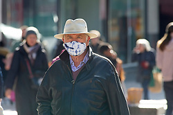 © Licensed to London News Pictures 21/10/2021.<br /> Bromley, UK, A man wearing a protective face mask in Bromley High Street, South East London. The coronavirus infection rate continues to rise as the Health Secretary Sajid Javid warning that cases could hit 100,000 a day in the winter months. Photo credit:Grant Falvey/LNP