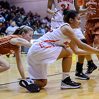 012415       Cable Hoover<br /> <br /> Gallup Bengal Shenoah Begay (22) grabs up a loose ball and passes it away from Eldorado Eagle Ashley Reinert (11) Saturday at Gallup High School.