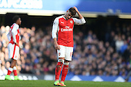Alex Oxlade-Chamberlain of Arsenal scratches his head. Premier league match, Chelsea v Arsenal at Stamford Bridge in London on Saturday 4th February 2017.<br /> pic by John Patrick Fletcher, Andrew Orchard sports photography.
