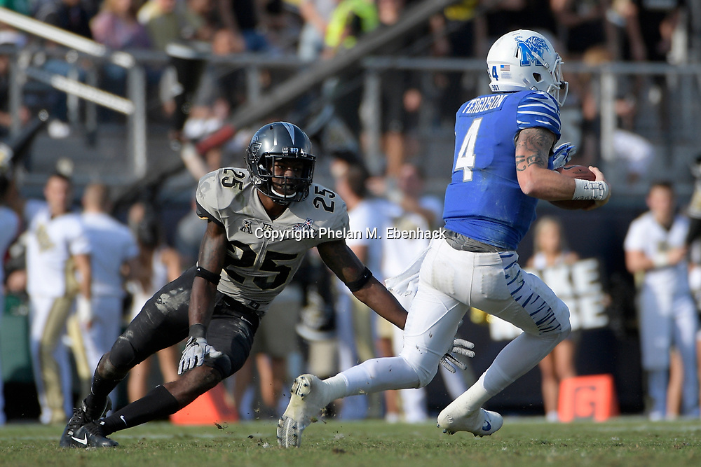 Central Florida defensive back Kyle Gibson (25) defends as Memphis quarterback Riley Ferguson (4) scrambles for yardage during the second half of the American Athletic Conference championship NCAA college football game Saturday, Dec. 2, 2017, in Orlando, Fla. Central Florida won 62-55. (Photo by Phelan M. Ebenhack)
