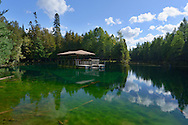 Kitch-iti-kipi is Michigan's largest freshwater spring. Over 10,000 gallons a minute gush from fissures in the underlying limestone. The flow continues throughout the year at a constant 45 degree Fahrenheit.<br /> <br /> Palms Book State Park,<br /> Michigan's Upper Peninsula