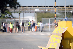 RUSTENBURG SOUTH AFRICA - MAY 18: Protesters display a placard near the Seraleng mining community on May 18, 2020, in Rustenburg, South Africa. Seraleng residents gathered at Sibanye k5 mine shaft Communities in the area alleged complaints of food parcel corruption by a local ward councillor. Grievances also included concerns with unemployment, loss of business and access to a social labour plan. (Photo by Gallo Images/Dino Lloyd)