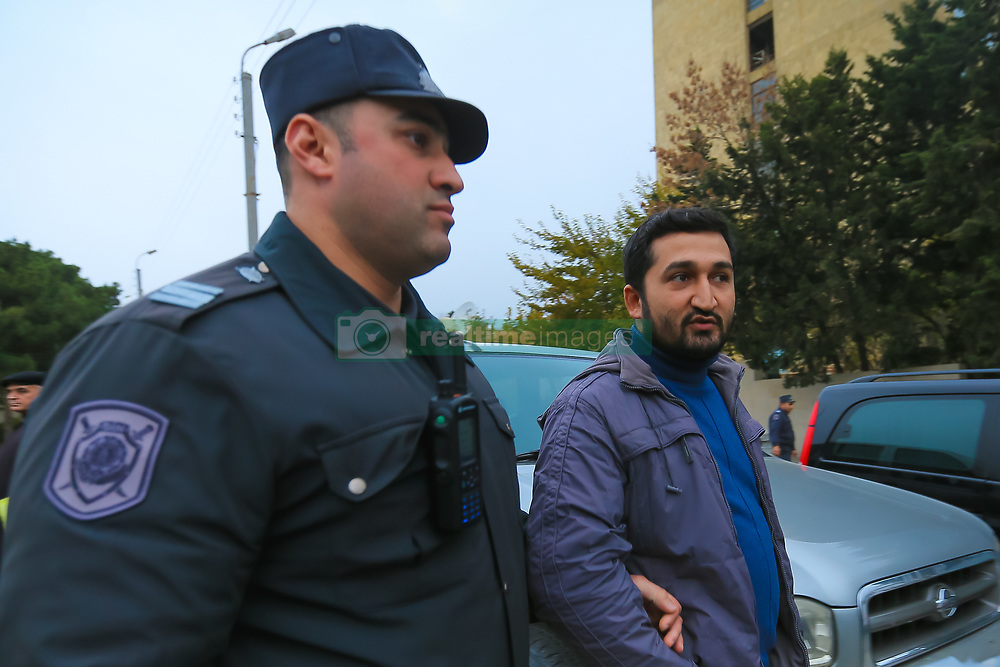 November 17, 2018 - Azerbaijan - Activists of the Popular Front Party and members of the National Council assembled in front of the Sabail police building, were put on the bus by the police and taken away in an unknown direction. Nov., 17. 2018.  On Saturday at around 3 p.m., several activists of the Popular Front Party and members of the National Council of Democratic Forces were detained by police in the Martyr Alley area. The detainees led by the leader of the Popular Front Party Ali Kerimli and the head of the National Council, Jamil Hasanli, were taken to the police station of the Sabail district. The reason for the detention was an attempt by the opposition to march through the streets of the city and repeat the route of students of Baku State University, which they passed on November 17, 1988. Then hundreds of students and employees of enterprises went to the streets demanding to protect the rights of Azerbaijan in the Nagorno-Karabakh issue. (Credit Image: © Aziz Karimov/Pacific Press via ZUMA Wire)