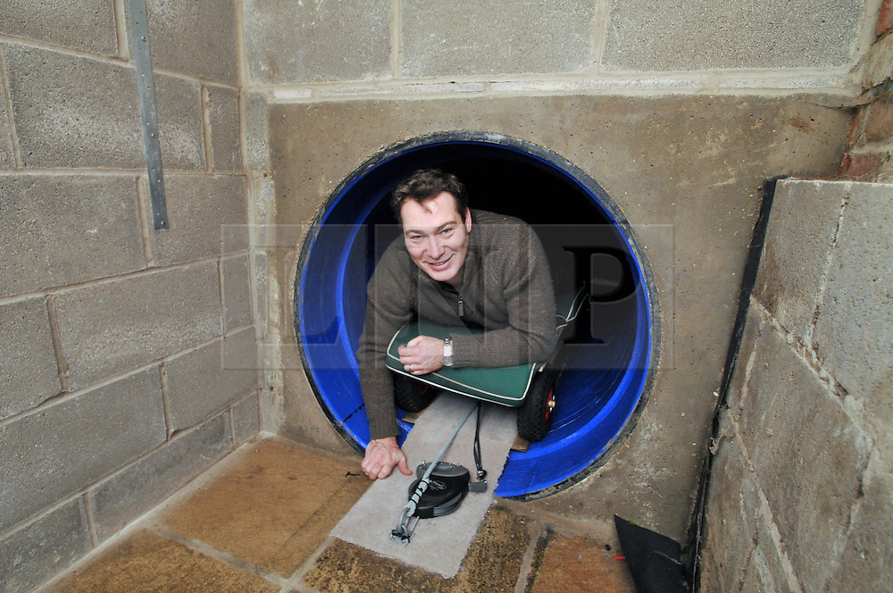 Licensed to London News Pictures 30/11/2016<br /> Artist Robert E. Fuller of Thixendale, North Yorkshire, has gone to unusual lenghts to get close to the animals he paints.  He has installed a 7m tunnel from his living room to his hide in the garden so he can reach it without disturbing the animals.  Pictured entering from his living room.  See story at<br /> www.samatkinsphoto.co.uk/download/ArtistTunnelStory/default.htm<br /> Photo Credit: Sam Atkins/LNP
