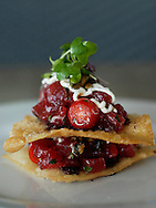 The Yellowfin Tuna Napolean, which consists of diced sashimi tuna, olive tapenade, cherry tomatoes, double yogurt aioli and fried wontons, is priced at $8 at Andrew Blair's, the American bistro and wine bar located at 1600 Montford Drive in Charlotte, NC.
