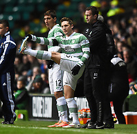 27/12/14 SCOTTISH PREMIERSHIP<br /> CELTIC v ROSS COUNTY<br /> CELTIC PARK - GLASGOW<br /> Celtic's Kris Commons limbers up in the dugout ahead of coming onto the park