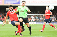 Hamza Bencherif of York City (4) tackles Joe Guest of Curzon Ashton (7) during the Vanarama National League North match between York City and Curzon Ashton at Bootham Crescent, York, England on 18 August 2018.