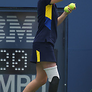 Denise Castelli, 26, from New Jersey  with other Ball boys and ball girls in action during the US Open Tennis Tournament, Flushing, New York. USA. 6th September 2012. Photo Tim Clayton