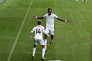Tammy Abraham of Swansea city (10) celebrates with Tom Carroll after he scores his teams 1st goal. Premier league match, Swansea city v Huddersfield Town at the Liberty Stadium in Swansea, South Wales on Saturday 14th October 2017.<br /> pic by  Andrew Orchard, Andrew Orchard sports photography.