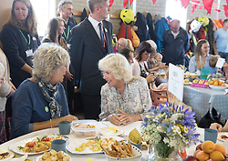 The Duchess of Cornwall meets residents from Tregunnel Hill, a mixed-use neighbourhood built on Duchy of Cornwall land in Newquay comprising open-market and affordable homes, as they have a picnic lunch inside Newquay Fire Station, Cornwall.