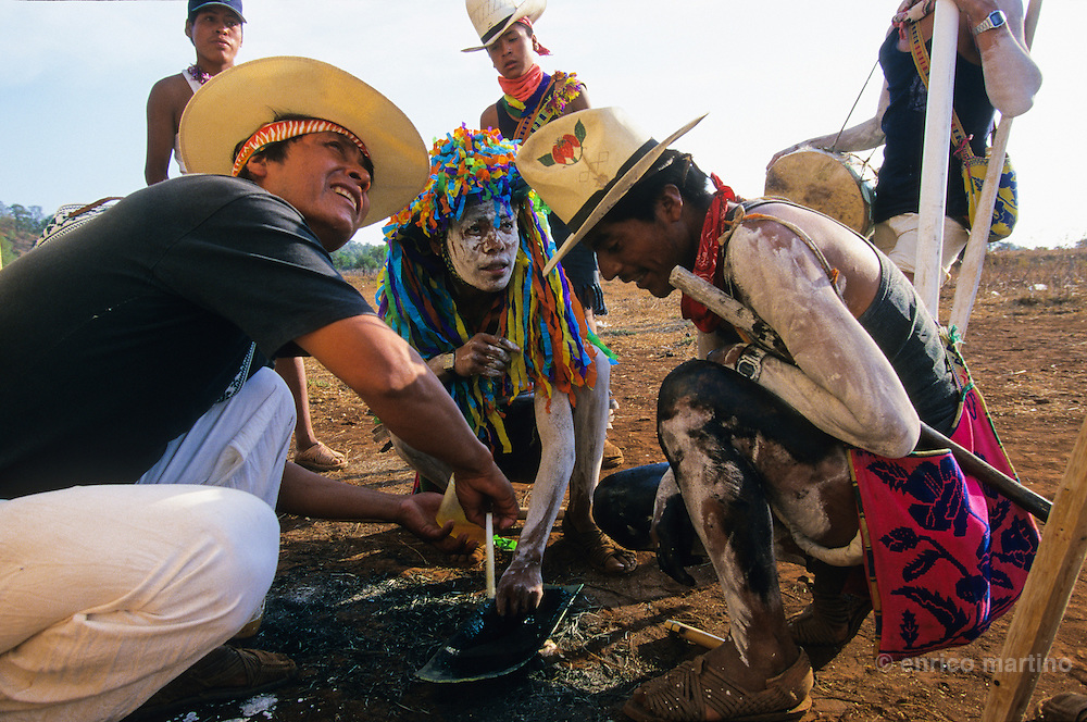 Sta Teresa del Nayar (Nayarit). At the sunrise, near the house of Black Centurion, the ?borrados? (the painted men) prepares vegetal colours with ash and honey. Coras are a small indigenous people living scattered in the mountains of Sierra Madre Central in Mexican state of Nayarit. The Coras still follows their traditions, protecting in a strong way their secret rites, that anthropologists believe the most interesting of Central America for their synchretism. The Holy Week, the most important religious event of the year, is characterized with impressive ceremonies. The catholic priest doesn't partecipate and the Black Centurion is the captain of Judea, the ?Jews?, the devil's militia looking for Jesus Christ to kill him. Violence is a essential part of the ceremonies and somebody can be killed in the struggles with wood swords.