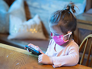 Willow Priore, 4, wears a mask made by her sister Audrey (not seen) while she does homework with her siblings in their dining room Wednesday, March 25, 2020 at in their home in Holland, Pennsylvania. With schools closed from coronavirus, parents have now become teachers as well. (WILLIAM THOMAS CAIN/PHOTOJOURNALIST)