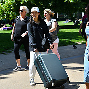 London, UK. 27 June 2019. UK Weather - Traveler misery for an early Hotel Checkout suntan to kills time at the Hottest week in June 2019 at Green park, London, UK
