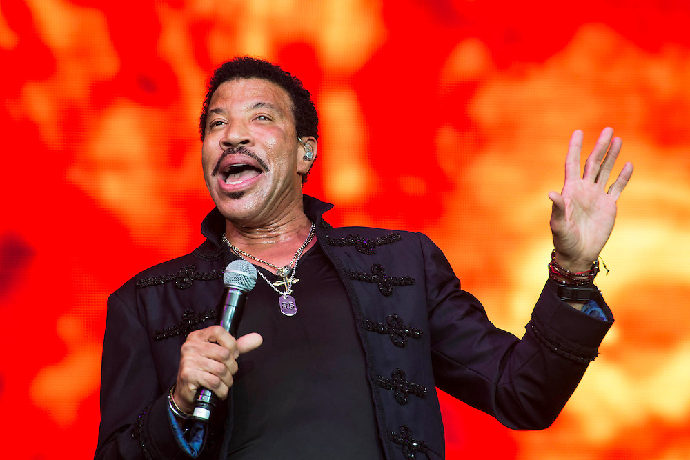 Lionel Richie plays the Pyramid Stage to a packed and enthusiatic audience. The 2015 Glastonbury Festival, Worthy Farm, Glastonbury.