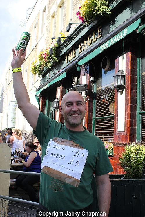 Street seller on stall duig Notting Hill Carnival