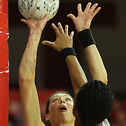 Irene Van Dyk, New Zealand, in action in her 200th test match, shoots while challenged by Eboni Beckford-Chambers, England, during the New Zealand V England, New World International Netball Series, at the ILT Velodrome, Invercargill, New Zealand. 6th October 2011. Photo Tim Clayton...