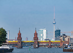 Oberbaum Bridge on River Spree  and  skyline in Berlin Germany