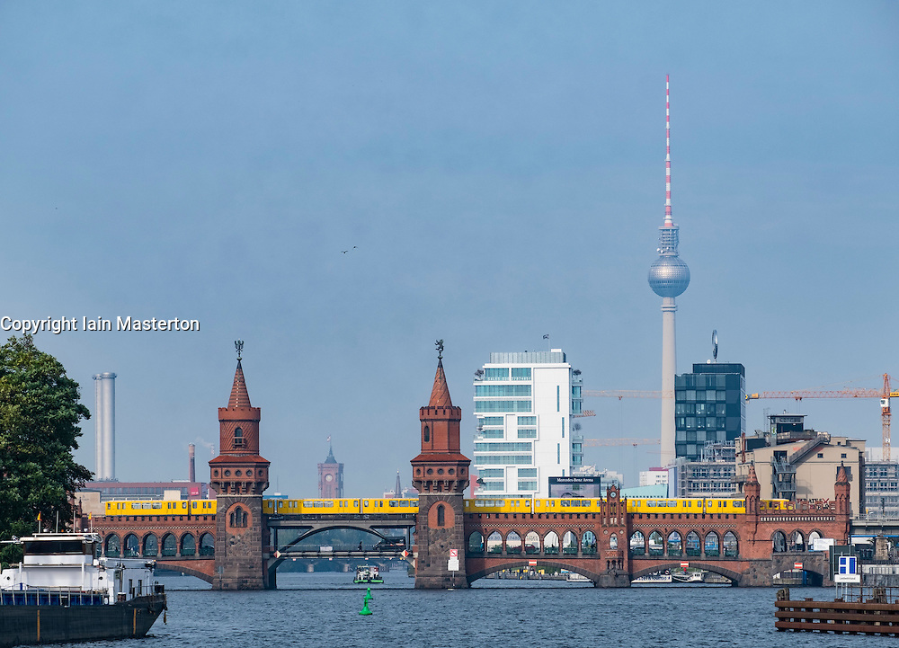Oberbaum Bridge on River Spree  and  skyline in Berlin Germany
