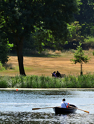 © Licensed to London News Pictures. 13/07/2018<br /> Bexleyheath, UK.<br /> Hot weather heat wave continues today.<br /> Danson Park Lake in Bexleyheath.<br /> Photo credit: Grant Falvey/LNP