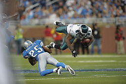 DETROIT - SEPTEMBER 19: Wide Receiver Jason Avant #81 of the Philadelphia Eagles gets a first down as he is upended by defensive back Randy Phillips #25 the Detroit Lions on September 19, 2010 at Ford Field in Detroit, Michigan. The Eagles won 35.32. (Photo by Drew Hallowell/Getty Images)  *** Local Caption *** Jason Avant;Randy Phillips