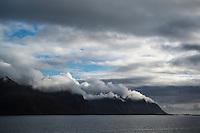 Clouds blow over mountain headland, Austvågøya, Lofoten Islands, Norway